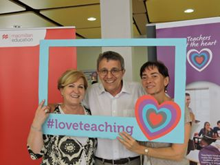 3 teachers with a #loveteaching sign
