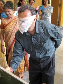 Blindfolded teacher with one hand behind back image